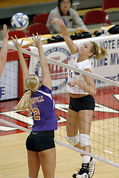 24 November 2006: Sara Thomas strikes the ball past the arms of Kerry Sylvester during a Quarterfinal match between the Evansville University Purple Aces and the Missouri State University Bears.The Tournament was held at Redbird Arena on the campus of Illinois State University in Normal Illinois.<br />