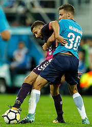August 24, 2017 - Saint Petersburg, Russia - Emanuel Mammana (R) of FC Zenit Saint Petersburg and Zakaria Labyad of FC Utrecht vie for the ball during the UEFA Europa League play-off round second leg match between FC Zenit St. Petersburg and FC Utrecht at Saint Petersburg Stadium on August 24, 2017 in Saint Petersburg, Russia. (Credit Image: © Mike Kireev/NurPhoto via ZUMA Press)