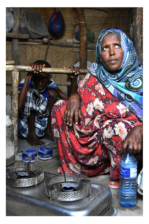 An Afar woman explains the use of biofuel in her home in the Asaita Refugee Camp, Afar, Ethiopia 2016