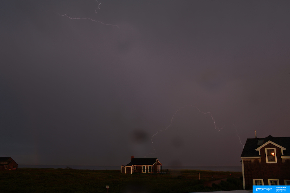 A thunder and lightening storm hits the coastline at Cisco Beach, Nantucket, Nantucket Harbor on Nantucket Island, Massachusetts, USA. Photo Tim Clayton