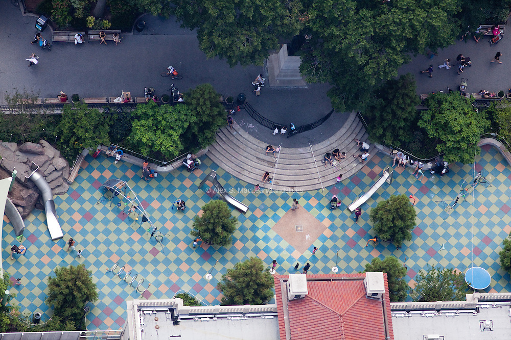 Citygoers sit on the steps of a playground/plaza at the resdesigned Union Square Park, by Michael Van Valkenburgh Associates