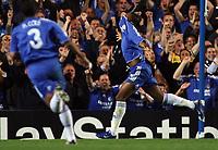Photo: Paul Thomas.<br /> Chelsea v Barcelona. UEFA Champions League, Group A. 18/10/2006.<br /> <br /> Didier Drogba (R) of Chelsea celebrates his goal.
