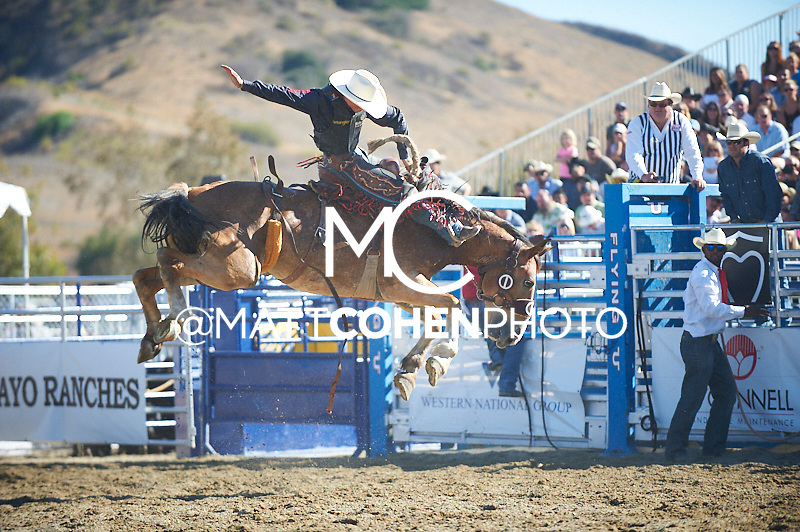 Saddle bronc rider Rusty Wright of Milford, UT rides Backlash at the Rancho Mission Viejo Rodeo in San Juan Capistrano, CA.<br /> <br /> <br /> UNEDITED LOW-RES PREVIEW<br /> <br /> <br /> File shown may be an unedited low resolution version used as a proof only. All prints are 100% guaranteed for quality. Sizes 8x10+ come with a version for personal social media. I am currently not selling downloads for commercial/brand use.
