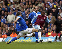 Picture: Henry Browne.<br />Date: 19/10/2003.<br />Birmingham City v Aston Villa FA Barclaycard Premiership.<br />Darius Vassell of Villa avoids a challenge from City's Stephen Clemence