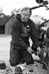 Rowdy Schenck makes roadside repairs on his 1928 Harley-Davidson JD during Stage 7 of the Motorcycle Cannonball Cross-Country Endurance Run, which on this day ran from Sedalia, MO to Junction City, KS., USA. Thursday, September 11, 2014.  Photography ©2014 Michael Lichter.
