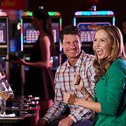 couple at slot machine in casino in California
