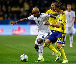 November 21, 2018 - Stockholm, Sweden - Kristoffer Olsson (R) of Sweden and Ari of Russia vie for the ball during the UEFA Nations League B Group 2 match between Sweden and Russia on November 20, 2018 at Friends Arena in Stockholm, Sweden. (Credit Image: © Mike Kireev/NurPhoto via ZUMA Press)