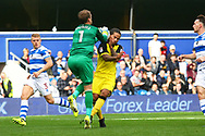 Queens Park Rangers goalkeeper Alex Smithies (1) and Burton Albion striker Sean Scannell (9) clash during the EFL Sky Bet Championship match between Queens Park Rangers and Burton Albion at the Loftus Road Stadium, London, England on 23 September 2017. Photo by John Potts.