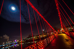 The Moon and Jupiter seen from the South Portland Street Suspension Bridge, over Glasgow's River Clyde.