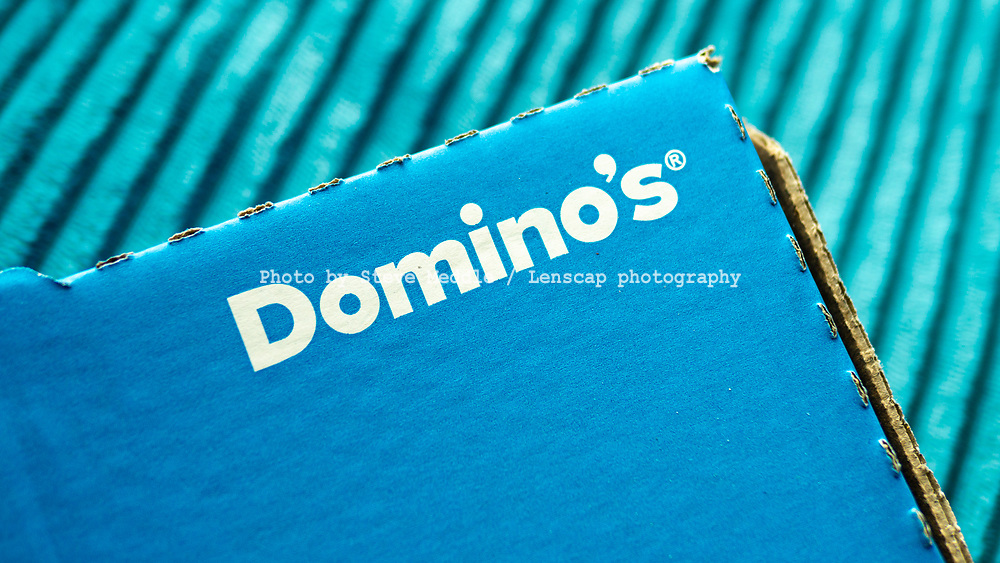 London, England - February 17, 2019: A Domino's Pizza delivery box. Domino's Pizza Inc, An American take away pizza chain founded in 1960