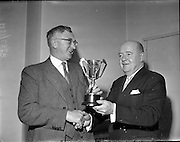 Smithwick Drama Cup Presented to An t-Oireachtas.1960..27.01.1960..01.27.1960..27th January 1960...Mr Walter A Smithwick ,Managing Director, Smithwick and Sons Ltd, Kilkenny,presented a trophy for the All Ireland Drama Festival of An tOireachtas to  Aindrias Ó Muimhneachain, Chairman of An tOireachtas. The cup will be awarded to the Gaelic Drama Group gaining the highest aggregate marks for production and presentation during the festival...Image shows Mr Walter Smithwick (right) presententing the trophy to Mr Aindrias Ó Muimhneachain at the formal ceremony.