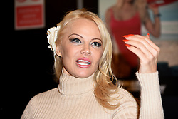 Ex-Baywatch babe Pamela Anderson signs autographs for fans at the 25th Paris Manga Manga & Sci-Fi Show held at Parc des Expositions in Paris, France on February 3, 2018. Anderson has taken her relationship with her much younger beau French football star Adil Rami, 31, to the next life by moving into his home in Marseille. Photo by Alain Apaydin/ABACAPRESS.COM