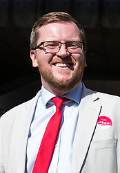 © Licensed to London News Pictures. 03/05/2018. London, UK. Labour's parliamentary candidate for the Cities of London & Westminster STEVEN SAXBY poses for a photo outside Pimlico Tube Station as part of 'Unseat Westminster Tory Council'. The gathering was arranged to round up volunteers to speak to Westminster residents who said they would vote for labour. Photo credit : Tom Nicholson/LNP