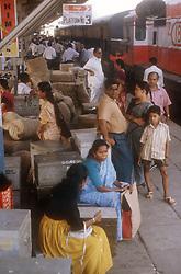 Passengers waiting on railway station platform at Cochin; Kerala; India,