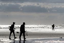 Fishermen and photographer on beach, Gulf of Mexico, East Beach, Galveston, Texas, USA