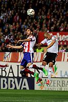 Atletico de Madrid´s Raul Garcia and Valencia CF´s Sofiane Feghouli during 2014-15 La Liga match between Atletico de Madrid and Valencia CF at Vicente Calderon stadium in Madrid, Spain. March 08, 2015. (ALTERPHOTOS/Luis Fernandez)