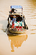 12 MARCH 2006 - CAI BE, TIEN GIANG, VIETNAM: A boat goes up a canal near Cai Be in the Mekong River delta. The Mekong is the lifeblood of southern Vietnam. It is the country's rice bowl and has enabled Vietnam to become the second leading rice exporting country in the world (after Thailand). The Mekong delta also carries commercial and passenger traffic throughout the region.  Photo by Jack Kurtz
