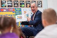"""US Sen. Robert Casey (D-PA.) reads """"The Little Engine That Could"""" to students after touring the facility Monday, February 24, 2020 at Bright Beginnings Daycare in Bensalem, Pennsylvania. (WILLIAM THOMAS CAIN/PHOTOJOURNALIST)"""