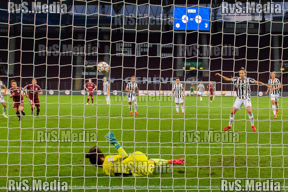 GENEVA, SWITZERLAND - OCTOBER 06: Goalkeeper Ines Pereira #12 of Servette FC Chenois feminin stops a penalty kick from Andrea Staskova #9 of Juventus Women during the UEFA Women's Champions League group A match between Servette FCCF and Juventus at Stade de Geneve on October 6, 2021 in Geneva, Switzerland. (Photo by Basile Barbey/RvS.Media)