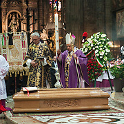 MILAN, ITALY - JUNE 14: His Eminence Cardinal Dionigi Tettamanzi Archibishop of Milan blesses the coffin at the funeral of Monsignor Luigi Padovese at the Duomo on June 14, 2010 in Milan, Italy. Monsignor Luigi Padovese Bishop in Anatolia was murdered by his own driver on June 3rd in Iskenderun, Turkey ***Agreed Fee's Apply To All Image Use***<br /> Marco Secchi /Xianpix<br />  tel +44 (0) 207 1939846<br />  e-mail ms@msecchi.com <br /> www.marcosecchi.com