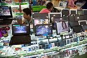 Computer sellers inside e-plaza digital square shopping mall. Zhongguancun or Zhong Guan Cun, is a technology hub in Haidian District, Beijing, China. It is situated in the northwestern part of Beijing city. Zhongguancun is very well known in China, and is often referred to as China's Silicon Valley. This is Beijing's computer district with numerous tech companies offices situated here amongst the many malls which sell electronics and electrons equipment of all kinds. The tech park started as a small office where two decades ago some students from a nearby university decided that computer equipment may be a thing of the future so set up a small company. It has expanded in this time to  cover many square kilometres.