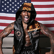 """WINTER HAVEN, FL - MAY 05: Boxer Willie Monroe Jr. screams as he poses at the Winter Haven Boxing Gym on May 5, 2015 in Winter Haven, Florida. Monroe will challenge middleweight world champion Gennady """"GGG"""" Golovkin for the WBA world championship title in Los Angeles on May 16.  (Photo by Alex Menendez/Getty Images) *** Local Caption *** Willie Monroe Jr."""