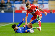 Marcus Tavernier (7) of Middlesbrough battles for possession with Ryan Giles (26) of Cardiff City during the EFL Sky Bet Championship match between Cardiff City and Middlesbrough at the Cardiff City Stadium, Cardiff, Wales on 23 October 2021.