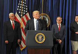April 27, 2017 - Washington, DC, United States of America - U.S President Donald Trump along with Vice President Mike Pence, left, and Secretary of Veterans Affairs, Dr. David Shulkin, right, thanks Veterans for their service before signing the Improving Accountability and Whistleblower Protection Executive Order during an event at the Veterans Administration April 27, 2017 in Washington, D.C. (Credit Image: © Robert Turtil/Planet Pix via ZUMA Wire)
