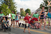 Laconia's annual 4th of July parade marches down North Main Street towards Opechee Park Thursday.  (Karen Bobotas/for the Laconia Daily Sun)