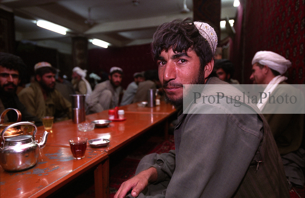 At a local restaurant in Kandahar city, locals drink tea after dinner.