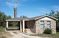 Drilling rig behind a home in Big Spring, Texas in the Permian Basin.