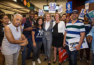 Jumaane Williams, the Democratic candidate for Lieutenant Governor of New York, invites Gubernatorial candidate Cynthia Nixon, and Zephyr Teachout, the candidate for Attorney General, to campaign with him in his neighborhood Flatbush, Brooklyn. At their final stop, they posed for a group  photo with commuters and campaign workers, at the  Church Avenue subway station.