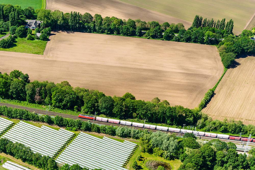 Nederland, Gelderland, Gemeente Zevenaar, 29-05-2019; Betuweroute met vrachttrein. De trein heeft de tunnel Zevenaar verlaten en is onderweg naar de grens met Duitsland. <br /> Betuwe route with freight train. The train has left the Zevenaar tunnel and is en route to the border with Germany.<br /> <br /> luchtfoto (toeslag op standard tarieven);<br /> aerial photo (additional fee required);<br /> copyright foto/photo Siebe Swart