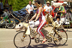 Stock photo of a woman riding on a skeleton bicycle