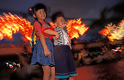Chinese children smle during a dragon lantern party in Kowlooon, on the eve of the handover of sovereignty from Britain to China, on 30th June 1997, in Hong Kong, China. Midnight signified the end of British rule, and the transfer of legal and financial authority back to China. Hong Kong was once known as fragrant harbour or Heung Keung because of the smell of transported sandal wood.