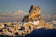 Goreme, Cappadocia, Nevsehir, Turkey, winter 2005. The castle of Ortahisar with Mt erciyes volcano in the background. The Valleys of the Goreme National Park offer some very good snow shoeing. Many people who visit in the summer do not realize that temperatures in winter can go as low as minus 25 celcius, with a meter of snow on the ground.Photo by Frits Meyst/Adventure4ever.com