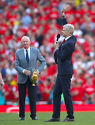 Arsenal manager Arsene Wenger gives an address to the fans after the final whistle