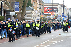 Fans surrounded by police presence prior to the match