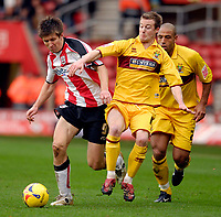 Photo: Alan Crowhurst.<br />Southampton v Burnley. Coca Cola Championship. 13/01/2007. Saints' Grzegorz Rasiak (L) tries to pass the defence.