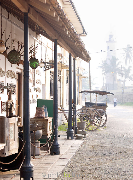 The front of an antiques store and Galle Lighthouse, Galle, Sri Lanka