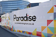 Hoardings up for the redevelopment of Paradise as the Coronavirus lockdown continues, the city centre is still very quiet while more traffic and people are returning, and with restrictions due to be relaxed further in the coming days, the quiet city may be coming to an end as businesses are set to start to reopen soon on 27th May 2020 in Birmingham, England, United Kingdom. Paradise, formerly named Paradise Circus, is the name given to an area of approximately 7 hectares in Birmingham city centre between Chamberlain and Centenary Squares. The area has been part of the civic centre of Birmingham since the 19th century. From 2015 Argent Group will redevelop the area into new mixed use buildings and public squares. Coronavirus or Covid-19 is a respiratory illness that has not previously been seen in humans. While much or Europe has been placed into lockdown, the UK government has put in place more stringent rules as part of their long term strategy, and in particular social distancing.