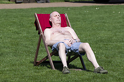 April 18, 2018 - London, London, UK - London, UK. A man sunbathes during hot weather in St James's Park, London. (Credit Image: © Rob Pinney/London News Pictures via ZUMA Wire)