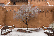 Snow covers a courtyard in the adobe style New Mexico Museum of Art in the historic district December 12, 2015 in Santa Fe, New Mexico.
