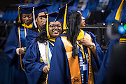 CSF-DC's Bryanna Johnson smiles as she walks into the Greensboro Coliseum for her NC A&T graduation on Saturday, May 14, 2016 (Tigermoth Creative/Chris English)