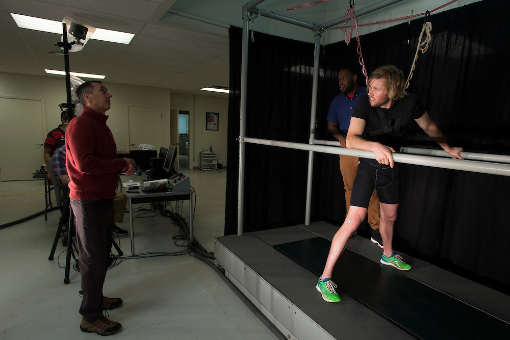 Ryan Hall visits with Dr. Peter Weyland at the SMU Locomotor Performance Lab in Dallas, Texas on March 18, 2016. (Cooper Neill for The New York Times)