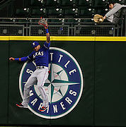 Mariners DH Nelson Cruz hits a home run that Texas center fielder Ian Desmond, pictured, can't catch, but fan -- at right -- can, in eighth inning, Monday, April 11, 2016, at Safeco Field in Seattle.<br /> <br /> Ken Lambert / The Seattle Times