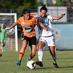 BRISBANE, AUSTRALIA - JANUARY 1: Angela Beard of the Roar and Gulcan Koca of the Victory compete for the ball during the round 10 Westfield W-League match between the Brisbane Roar and Melbourne Victory at AJ Kelly Park on January 1, 2016 in Brisbane, Australia. (Photo by Patrick Kearney/Brisbane Roar)