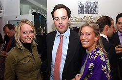 Left to right, MISS NATALIE BURGUN, LORD BUCKHURST and MISS OLIVIA BUCKINGHAM at a party to celebrate the opening of children's store Chippi Hacki at 8 Motcomb Street, London, SW1 on 24th November 2004.<br />