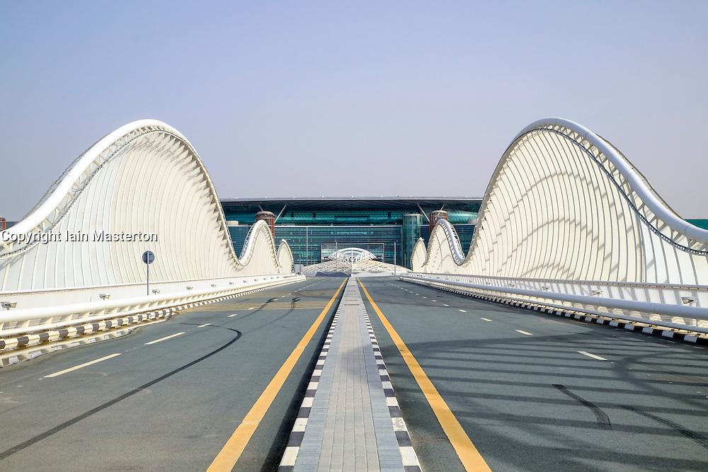 Modern highway bridge at approach to Meydan racecourse in Dubai United Arab Emirates