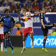 Tim Cahill, (centre), New York Red Bulls, challenges for the ball with Sam Cronin, (right), San Jose Earthquakes, during the New York Red Bulls Vs San Jose Earthquakes, Major League Soccer regular season match at Red Bull Arena, Harrison, New Jersey. USA. 19th July 2014. Photo Tim Clayton